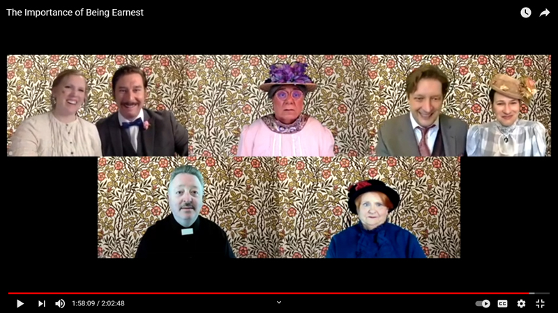 """Emily Sue and Soren Barker, Nick Azzaretti, and Michael Hovance with Jessica Plotin in the top row share a larger screen and the same William Morris wallpaper background with Mitchell Wellman and Ellie Busby in the bottom row, during the River Company's Zoom production of """"The Importance of Being Earnest"""". (screenshot)"""