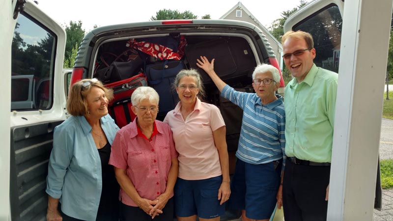 Mariellen Whelan (second from right) with a group of volunteers from the Second Congregational Church in Newcastle who transported trucks and vans full of clothing to Portland to help support immigrants rapidly entering the area. (Photo courtesy Mariellen Whelan)