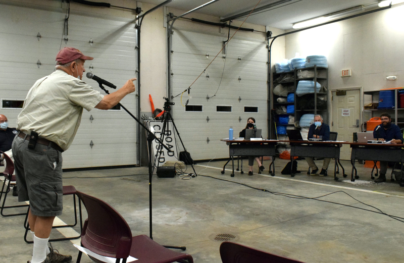 Newcastle resident Norman Hunt demands an answer to a question from the Newcastle Board of Selectmen during a meeting concerning Newcastle's Taniscot Engine Co. on Monday, Sept. 13. The meeting was attended by nearly 40 people and grew contentious at times. (Evan Houk photo)