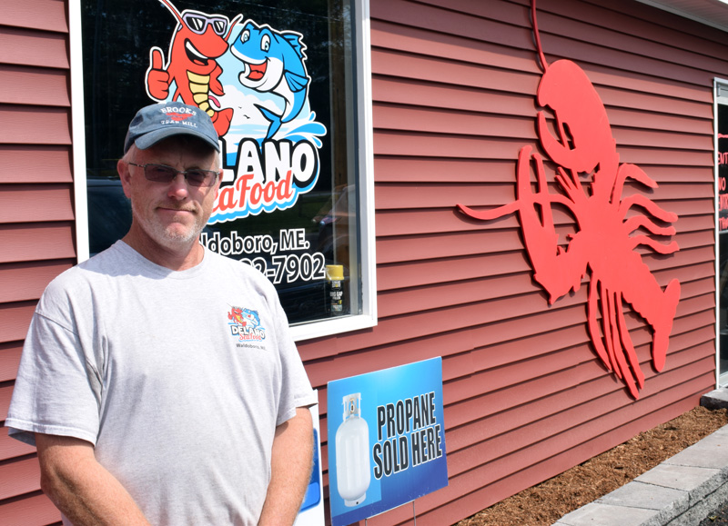 Kendall Delano Jr., co-owner of Delano Seafood Market in Waldoboro, stands outside of a newly constructed building that will house the market by October and offer twice as much retail space. Delano plans to hold a grand opening celebration and 20th anniversary bash for his business once the building is complete. (Evan Houk photo)