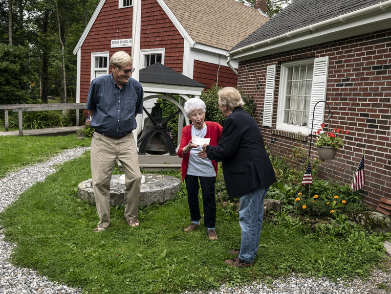 Christopher Stanley and Harry Hepburn of the Maine Antique Dealers Association present a check for $1,000 to Jean Lawrence, president of the Waldoborough Historical Society, on Wednesday, Sept. 15. Lawrence plans to use the funds to improve accessibility at the society's secondary location in West Waldoboro.  (Bisi Cameron Yee photo)