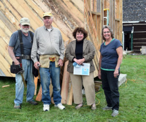 From left: Erik Ekholm, Dennis Merrill, Sue McKeen, and Cheryle Joslyn in front of the Whitefield Library and Community Center's in-progress storage shed on Sept. 28. (Nate Poole photo)