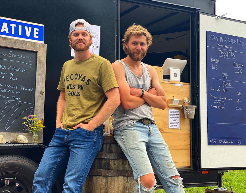 Hudson (left) and Zak Kuras (right) officially opened their new oyster bar, Brother Shucker, in Wiscasset in July. While the brothers currently operate the business out of a retrofitted trailer, they are in the process of renovating a storefront at 4 Railroad Avenue. (Photo courtesy Hudson Kuras)