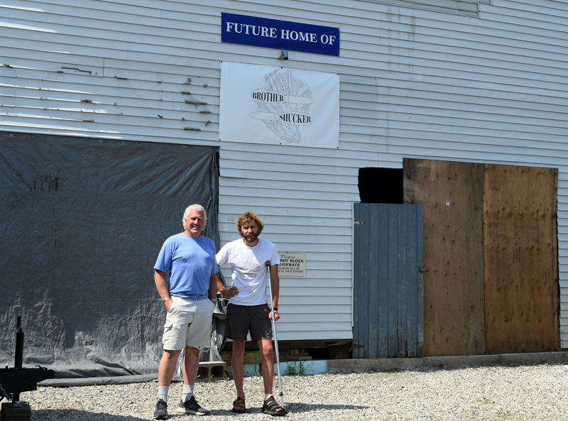 Zak Kuras and Craig Winslow in front of the raw bar's eventual homebase at 4 Railroad Avenue. Winslow and the Kuras brothers are hoping the have the restaurant up and running by early 2022. (Nate Poole photo)