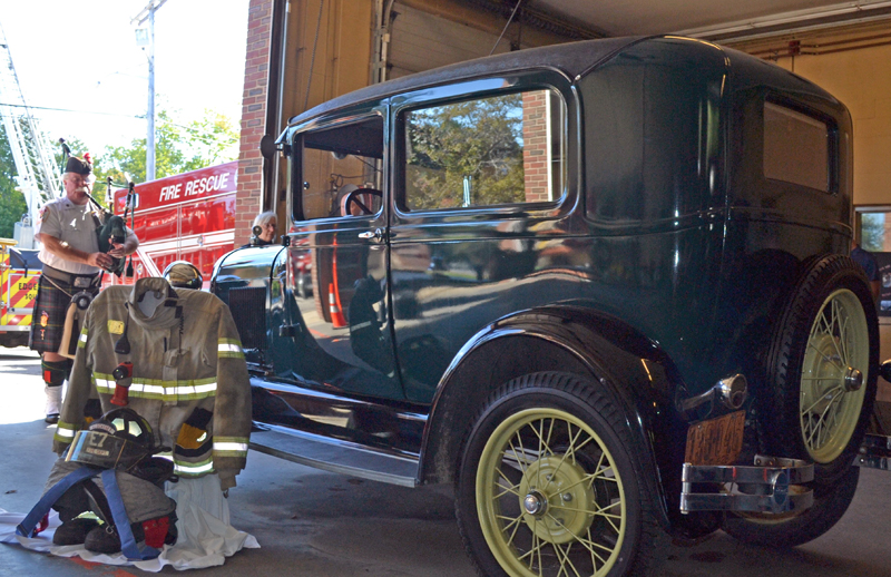 The pullout gear of the late Peter Rines was displayed next to his antique car during the Celebration of his life, held at the Wiscasset Fire Station, September 19, while David McLean played Amazing Grace on the bagpipe.  (Charlotte Boynton photo)