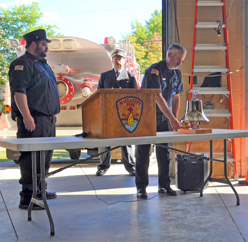 Wiscasset Fire Fighters Dan Averell, left and Matt Gordon conduct the bell ring ceremony. Wiscasset Fire Chief Ron Bickford observes the ceremony in the rear, at the Celebration of Life service for the late Peter Rines, Sunday, September 19, at Wiscasset Fire Station. (Charlotte Boynton photo)