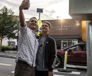 Jayden brown, 14, and father Ben take a back to school selfie before attending freshman and sophomore orientation at Lincoln Academy in Newcastle on Monday. Sept. 1. (Bisi Cameron Yee photo)