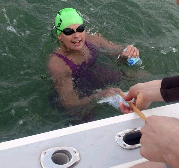 Alison Hayden rehydrates while swimming the length of the Damariscotta River. (photo provided by Alison Hayden)