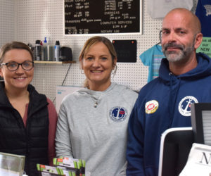 The new owner of Supplies Unlimited in Damariscotta, Stephanie Reichard, stands with previous owners Jane Oliver-Gravel and Gary Gravel behind the counter in the store on Oct. 5. Oliver-Gravel, Reichard's mother, said she is happy that the business will stay in the family and that nothing will change about the popular office supply and print shop. (Evan Houk photo)