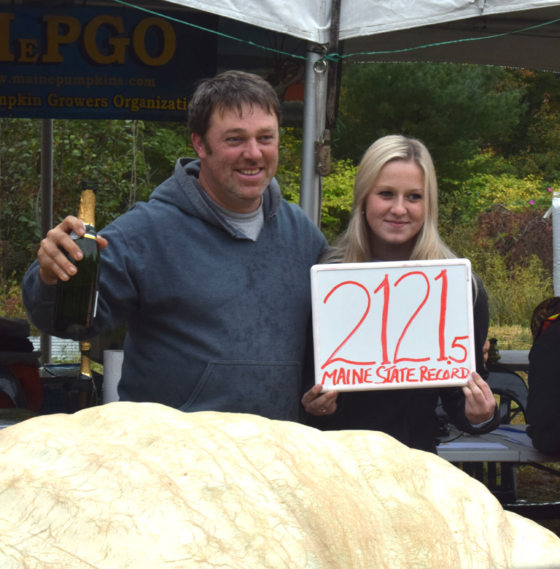 Edwin Pierpont stands with his daughter Paris Pierpont behind his 2,121.5-pound Maine state record giant pumpkin during the Damariscotta Pumpkinfest weigh off on Oct. 3. Paris Pierpont died in a single vehicle crash in Edgecomb on the evening of Oct. 10. (Evan Houk photo)