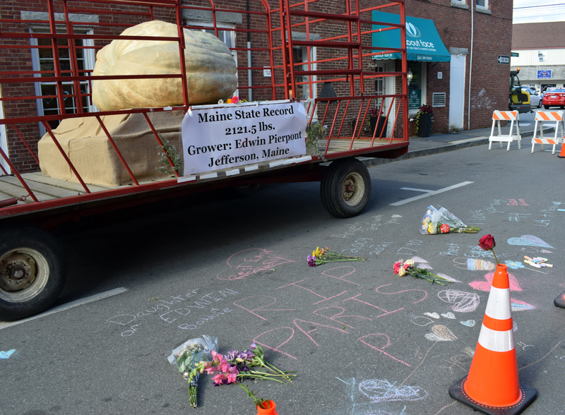 A memorial to Paris Pierpont, the daughter of Edwin Pierpont, the Jefferson man who won the Maine state record for heaviest giant pumpkin, has been installed in front of the prize-winning pumpkin on Theater Street in Damariscotta. Paris Pierpont died in a single-vehicle crash in Edgecomb on the evening of Oct. 10. (Evan Houk photo)
