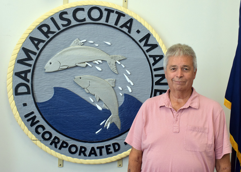 """Code Enforcement Officer Stanley """"Stan"""" Waltz stands in front of the Damariscotta town seal in the town hall on Friday, Sept. 24. Waltz is stepping back from his position in Damariscotta and Bremen, but will continue to work full-time for Waldoboro and Nobleboro. (Evan Houk photo)"""