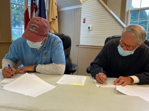 Signing contract for work on Pemaquid Falls Park are Peter Anderson (left), owner of Natural Concepts, Inc., a Bristol lansdscape contractor and stonemason, and Old Bristol Historical Society President Robert Ives, at the Bristol Town Hall on Sept. 28. (Courtesy photo)