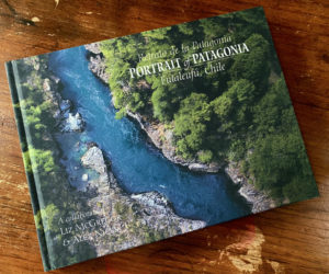 """A copy of """"Portrait of Patagonia - Futaleufu, Chile"""" rests on a table. Newcastle resident and visual storyteller Liz McGregor produced the book to share the scenery and culture of a place she considers her second home. (Photo courtesy Liz McGregor)"""