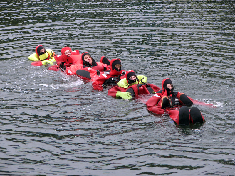 Swimming chain water survival in action. Pictured in their immersion suits from left: Nolan Gilbert, Spencer Gamage, Matt Hanna, Eben Lord, Tyler McFarland, and Caleb Soohey. (Courtesy photo)