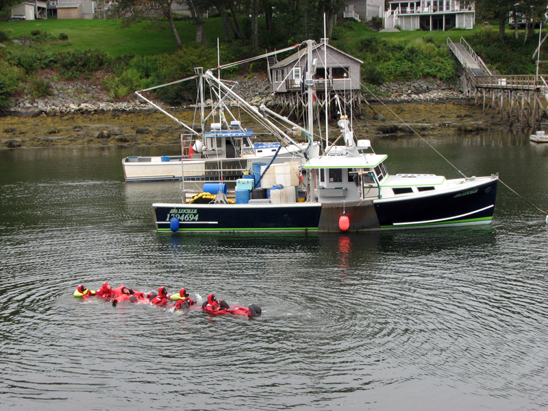 The survival swimming chain passing the F/V Ava Lucille resting on its mooring in New Harbor. (Courtesy photo)